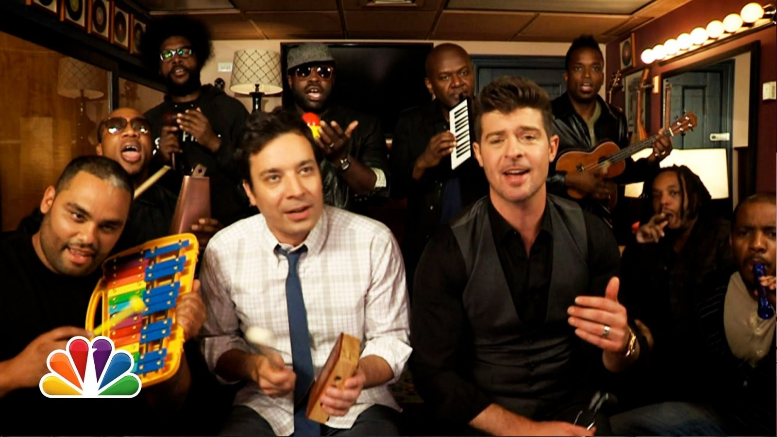 Adults playing kid toy instruments....