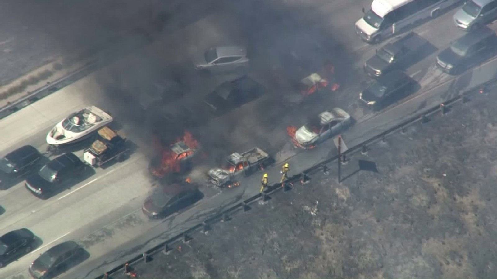 Yikes! Forest fire jumps highway and takes over cars. *VIDEO*