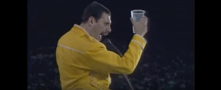 We lost this amazing man 25 years ago today... Queen's Freddie Mercury warms up with the crowd... Then sings Under Pressure...